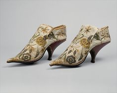 Mens shoes 1690-1700 French, silk and leather Men's adornment was every bit imbued with the elegance, tactile variance, and ostentation that marked women's clothing of the era. The fashionable eighteenth–century man was expected to convey a certain grace, and was required to enjoy the fine arts, music, and dancing. The romantic curviture of these shoes encourages the voyeuristic eye, each arc paralleled by the sensuality of the male arch and calf.