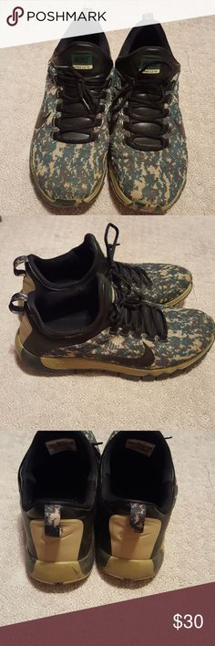 Nike, Men's Tennis Shoes Sylish camo men's Nike running shoe. Good used condition. Does show some sign of wear on sides of heels and there is a small snag on right front of shoe, see pic 7, barely noticeable with camo design. Shoes still has alot of life. Colors are green, tan, dark brown and black. Nike Shoes Athletic Shoes