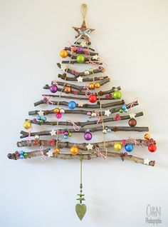 Put trimmed branches to good use by making your own Christmas tree for mounting on a wall. Great idea for a small home that doesn't really have the space for a traditional tree.