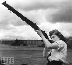 vintage everyday: Interesting Photos of Women in World War II Some 72,000 women would join the Wrens (Women's Royal Naval Service), freeing British sailors for combat duty by taking on home front jobs, like this Wren, an armorer at a Scottish Royal Air Force Base.