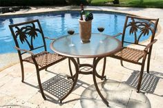 Coco Palm Patio 3 Piece Table and Arm Chair Bistro Set by Hospitality Rattan. $640.05. Style Traditional; Material Metal; Weight 50; Number of Boxes 3; Assembly Required Medium Assembly Required. This traditional Coco Palm Patio 3 Piece Table and Arm Chair Bistro Set incorporates a carved tropical palm tree design on an extruded aluminum frame that will not rust. The Coco Palm chairs are not only very durable, but are also stackable for easy storage. The dining table tops are...