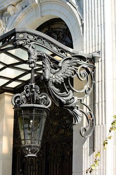 Beautiful griffon iron lantern door guardian