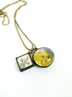 Hey, I found this really awesome Etsy listing at https://www.etsy.com/listing/100929092/pressed-flower-necklace-fleur-de-lis