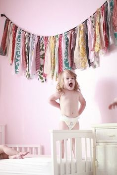 Fabric garland - what a fun decoration idea for the room of a little girl who adores pattern and color! by Maiden11976