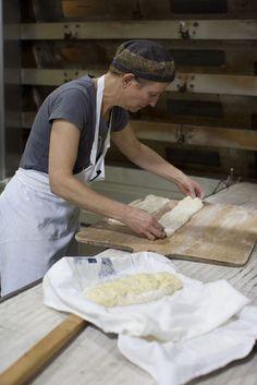 Macrina Bakery founder, Leslie Mackie making Schiacciata loaves - photography food preparation