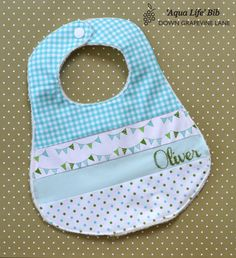 Personalized patchwork baby bib 'Aqua Life' - aqua blue bib with hand embroidered name. Handmade Gift Tags, Handmade Baby, Baby Bibs Patterns, Patchwork Baby, Baby Sewing Projects, Cool Baby Stuff, Burp Cloths, Baby Quilts, Baby Items