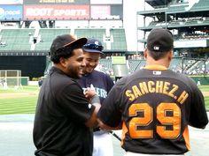 San Francisco Giants Pablo Sandoval and Hector Sanchez joke around in Spanish with Mariner Jesus Montero during Mariner batting practice.