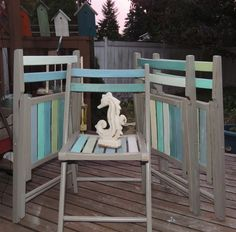 Found some beat-up wooden folding chairs and painted them in beachy hues! Used Annie Sloan French Linen for the base and a range of CeCe Caldwelll paints for the fun blues and greens.