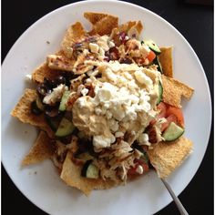 Greek nachos. Homemade pita chips made with whole wheat pitas, olive oil, and garlic powder, baked at 400 till crispy. Topped with a mix of cucumber, tomato, red onion, kalamata olives, and Greek vinegarette. That was then topped with chicken marinated in the vinegarette and grilled, hummus, and reduced fat feta.