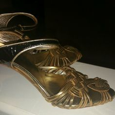 Gucci Metallic Shoes Gold metallic with black ankle strap/heel. These are authentic.  Will look for dust cover. Size:8M Made in Italy Gucci Shoes Heels