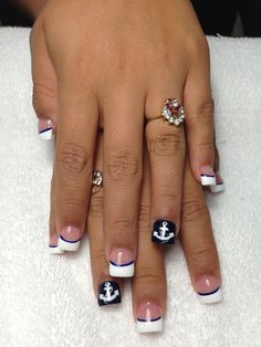 Simple French with a line to separate the tips and show off the ring finger with an anchor!