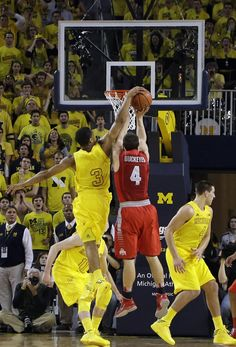 Trey Burke blocks OSU's Aaron Craft to save OT win in 2013.