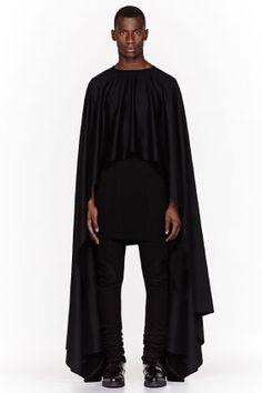 THAMANYAH Black Fleece & angora EHRAM cape --- Proportions are insane, but this probably looks great in motion. Or in front of a giant fan.