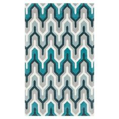 Hand-tufted rug with geometric motif.  Product: RugConstruction Material: 100% PolyesterColor: Ice blue, silvered gray, blue haze, turquoise and teal blueFeatures: Hand-tufted Note: Please be aware that actual colors may vary from those shown on your screen. Accent rugs may also not show the entire pattern that the corresponding area rugs have.Cleaning and Care: Blot stains