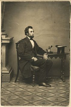 """President-elect Abraham Lincoln, February 24, 1861 by Alexander Gardner at the Matthew Brady Studio.   Popular photographer, Gardner was outstanding in his composition and subject matter. However, one will find that technically the consistency on his photo prints vary greatly - with major foxing and fading on many. This example """"from Lincoln's """"inkwell portrait series"""" shows great contrast and has fortunately lasted the test of time."""