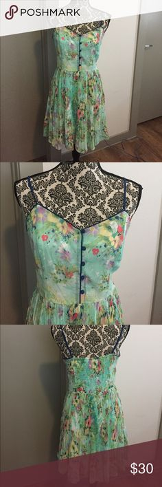 Beautiful floral print dress Beautiful sleeveless with spaghetti straps dress.  Love the pleating in skirt and buttons in the front. LC Lauren Conrad Dresses Midi