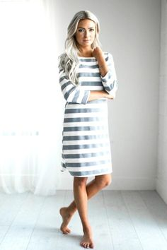 Grey and white knee length striped dress. Loose fit, women fashion dress to pair with shoes or boots for the perfect fall outfit. Comfortable dress that's great for mom's style.