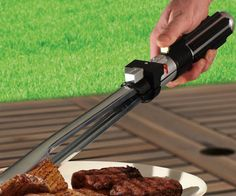 Lightsaber BBQ Tongs  Use the Force to ensure all your meats are cooked to perfection by using these lightsaber BBQ tongs. These intergalactic tongs feature a lightsaber inspired handle that comes with a specially designed red sheath that masks the metallic BBQ tongs in true lightsaber fashion.  $33.50  Check It Out  Awesome Sht You Can Buy