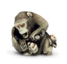 An Ivory Netsuke Signed Mitsuhide, Edo Period (18th century) Of a monkey with two young
