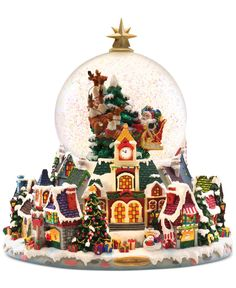This Christopher Radko snow globe brings a beautiful Christmas village to life. With a colorful detailed design, this piece will add joy to your home for years to come. | Imported | Glass/polyresin |