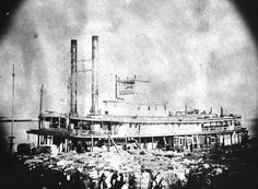 Florida Memory - Steamship docked and waiting to be loaded with cotton and other goods - Apalachicola, Florida