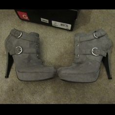 Grey guess booties Grey guess booties with silver buckles and zipper in the inside size 6.5 with box only worn a few times Guess Shoes Ankle Boots & Booties