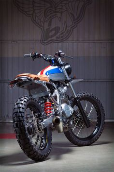It's a Honda NX650 scrambler built by the guys at Kiddo Motors.