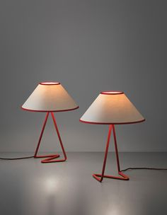 JEAN ROYÈRE Pair of 'Flic Flac' table lamps, 1950s Painted metal, paper shades. Each: 40 cm (15 3/4 in.) high