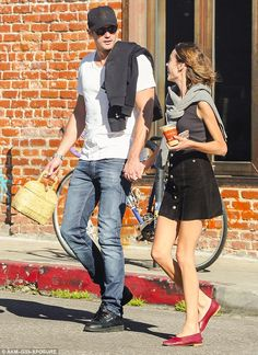 Alexa Chung, too sweet in red flats with a straw basket bag and Alex Skarsgard.