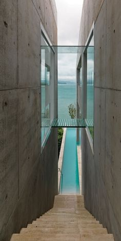 Nice contrast of materials – Glass bridge between concrete walls