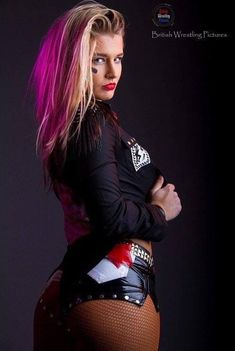 Toni Storm, all that ass Wrestling Posters, Women's Wrestling, Body Fitness, Divas Wwe, British Wrestling, Hottest Wwe Divas, Red And Black Jacket, Wwe Female Wrestlers, Female Athletes