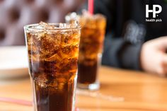 Double cool ice soft drink cola carbonated liquid fresh food with soda water, white dish on wooden table with handsome man sitting brown sofa in pizzeria restaurant. Diet Drinks, Beverages, Coca Cola, Sugar Consumption, Cardiac Diet, Pcos Diet, Fast Food Chains, Bad Food, Foods To Avoid