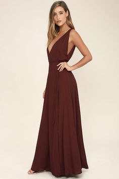 The Strictly Ballroom Burgundy Maxi Dress is sure to stun at any occasion! Lightweight woven fabric shapes a plunging V-neck and back. A tying waist sits atop a full, wrapping maxi skirt. Hidden back zipper.