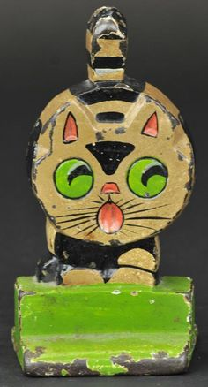 "CAT WITH WEDGE DOORSTOP Hubley, child's doorstop, depicts whimsical cat in round form with amusing expression and tail up, nice bright paint. 6"" h. (Exc.-Pristine Cond.)"