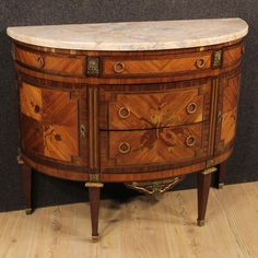 2500€ French inlaid demi lune dresser of the early 20th century.  Visit our website www.parino.it #antiques #antiquariato #furniture #inlay #antiquities #antiquario #comò #commode #dresser #chest #drawer #golden #gold #decorative #interiordesign #homedecoration #antiqueshop #antiquestore
