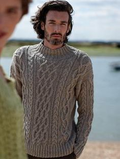 Knit this cable sweater with ribbing detail. Perfect for a summer evening.