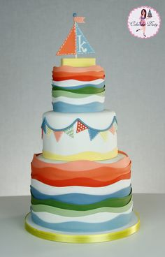 My customer sent me a pic of a cake to replicate. It was a two tier cake and the pic was a low resolution and it blurred when . Cupcakes, Cupcake Cakes, Nautical Cake, Sailboat Cake, Nautical Theme, Sea Cakes, Pink Cakes, Party Fiesta, First Birthday Cakes