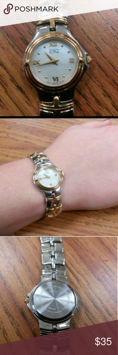 Esquire by movado ladies watch! Fully Functional! Two toned gold/silver stainless steel Swiss quartz movement, pearl dial roman numerals in excellent condition and working! Esquire Accessories Watches