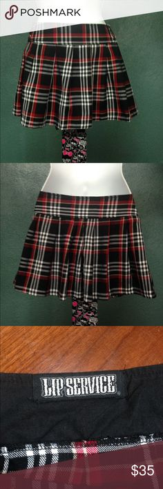 Punk Rock Lip Service Plaid Mini! Lip Service trendy, super punk rock mini skirt!  This skirt is a size Medium  and will easily fit sizes 4-9  in women's. Skirt is very colorful and in excellent condition. Lip service Skirts Mini