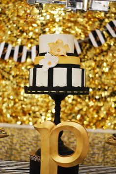 Gorgeous cake at a black and gold 50th birthday party! See more party planning ideas at CatchMyParty.com!