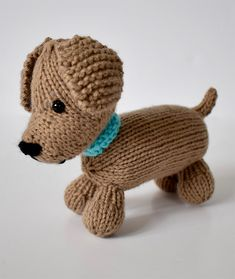 Free Knitting Pattern for Loyal Puppy - Dog softie toy designed by Amanda Berry. All pieces are knitted flat (back and forth) on a pair of straight knitting needles.