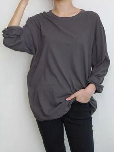 Dark grey sweater.
