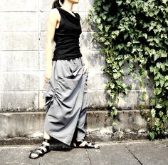 This masterpiece of design is all about movement, volume and asymmetry — The pants is made of medium weight cotton. One side pocket, easily adjustable waistband, asymmetrical hemline. The ultimate summer pant!  An awesome harem pants with a trick —Drawstrings which snap onto the hem to create different lengths and to create an asymmetric hemline for a variety of looks! Can be worn in two style, just turn it to the front or to the back. This pants is very comfortable & unique in style.  * ...