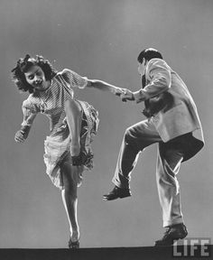 Kaye Popp & Stanley Catron demonstrating a step of The Lindy Hop. (Photo by Gjon Mili//Time Life Pictures/Getty Images)  Jan 1, 1943