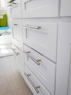 White Kitchen With Glass Tile Backsplash and Stainless Steel Appliances : Designers' Portfolio : HGTV - Home & Garden Television