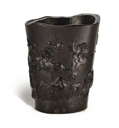 A CARVED ZITAN 'PRUNUS' BRUSHPOT<br>QING DYNASTY, 17TH / 18TH CENTURY | Lot | Sotheby's