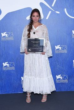 Matilde Gioli in a romantic Valentino Spring 2017 white lace dress at the photocall of the L'Oreal Paris Award for the Cinema during the 73rd Venice Film Festival.