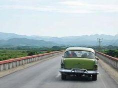 Classic Cuban car driving away
