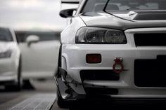White and in sight. Nissan Gtr R34, R34 Gtr, Fancy Cars, Cool Cars, Nissan Infiniti, Nissan Gtr Skyline, Jdm Cars, Tuner Cars, Import Cars