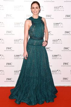 Blunt went for a monochromatic moment with emerald jewels to match her feminine lace dress.